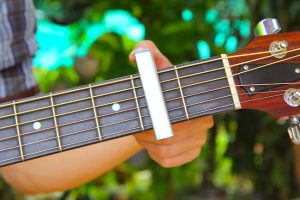 using a guitar capo